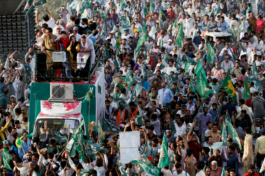 Supporters of the Pakistan Muslim League - Nawaz (PML-N) chant and march towards the airport to welcome ousted Prime Minister Nawaz Sharif and his daughter Maryam, in Lahore